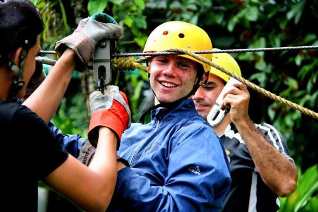 Teen gets ready to zip-line on his summer Spanish immersion teen tour in Costa Rica.