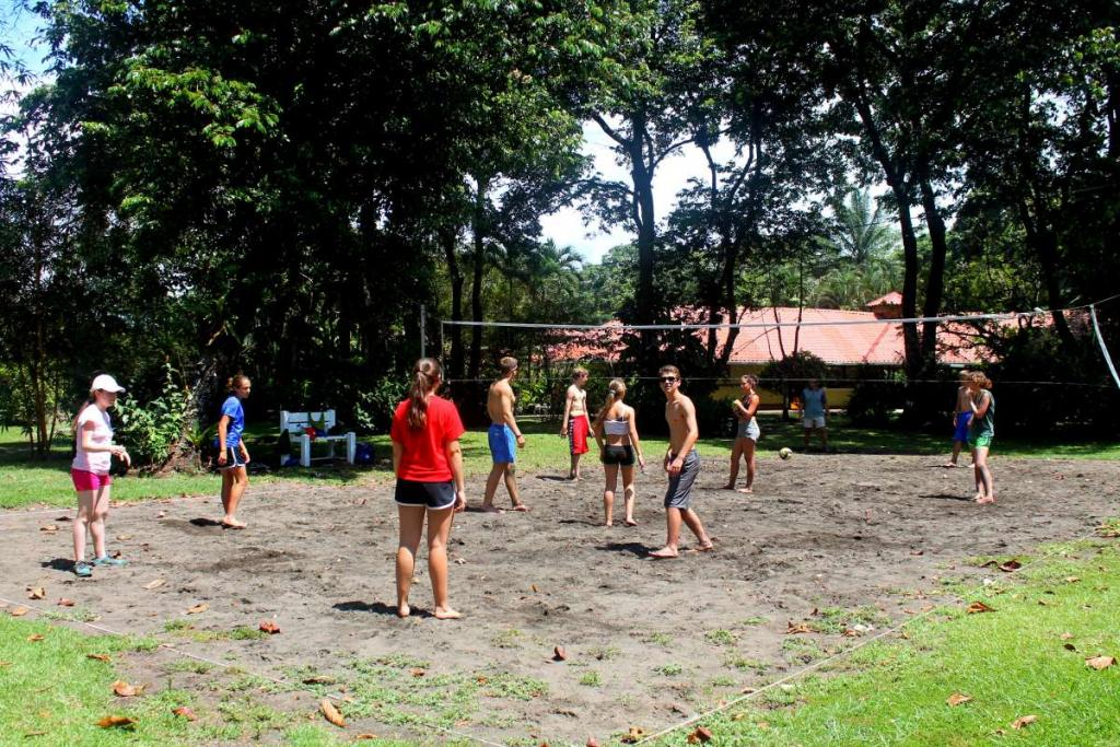 Group of teens plays games outside on their summer service and Spanish Language program in Costa Rica.