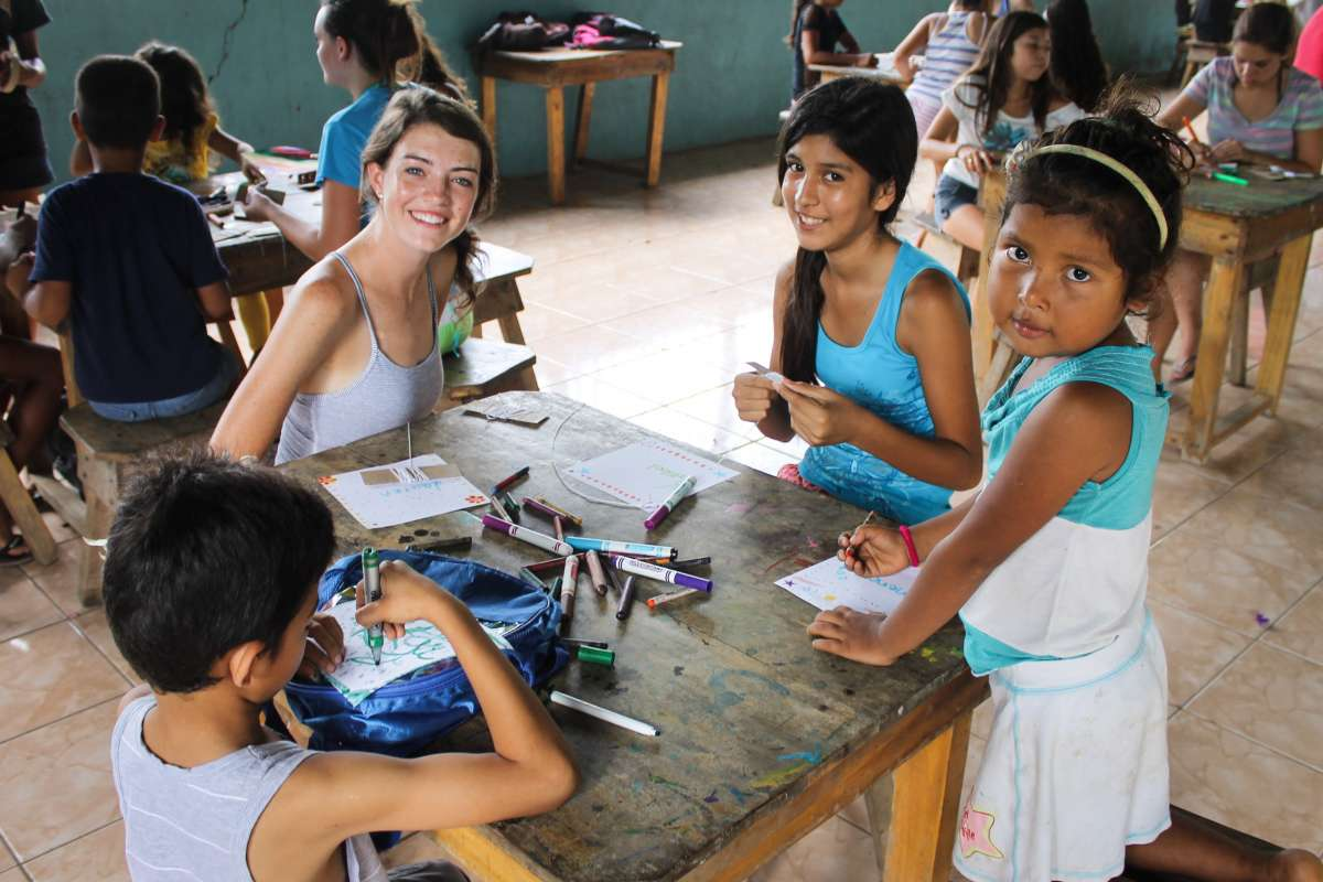 Teens spend time with local children on service and Spanish language immersion program in Costa Rica.