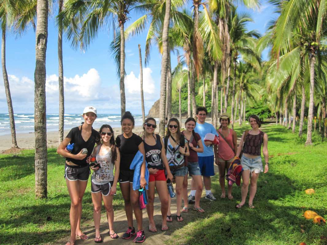 Teens take in the scenery of palm-lined beaches in Costa Rica on summer travel program.