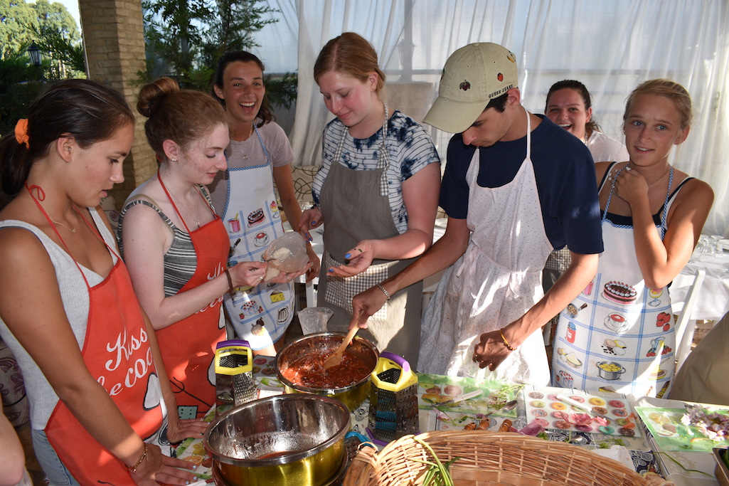 High school travelers try their hand at Greek cooking on the island of Lefkada in Greece on their teen tour.