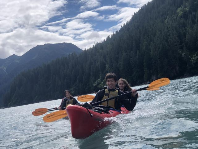 Older teens go kayaking on summer adventure program in Alaska.