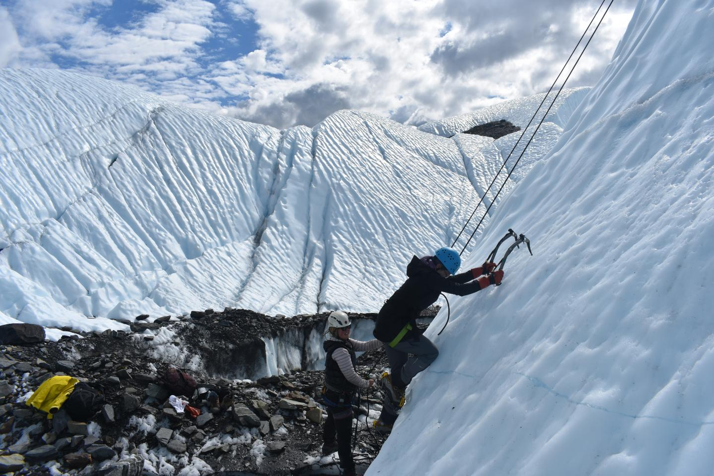 Teen goes ice climbing in Alaska on summer adventure and travel program.