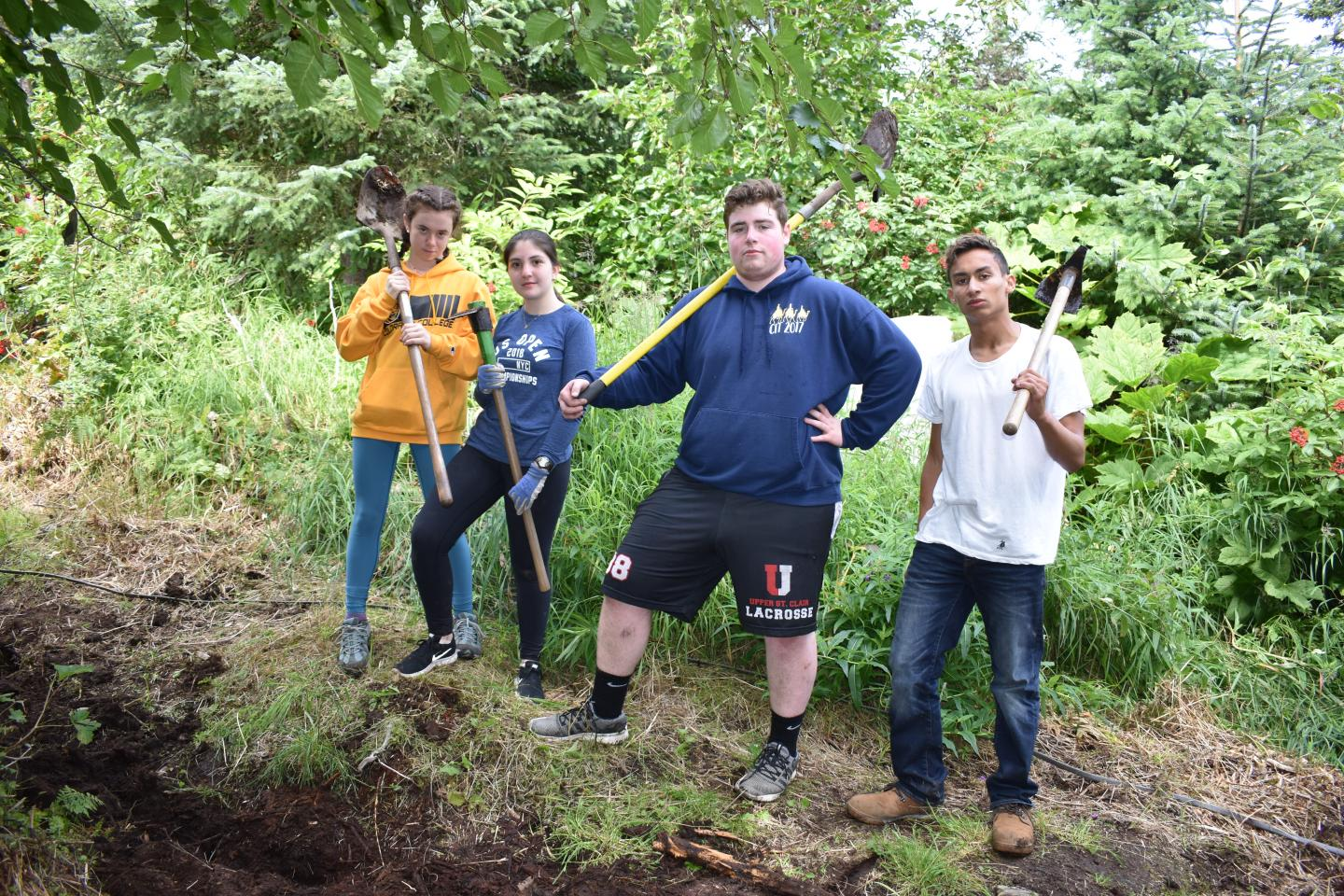Teens do service work in the wilderness on summer adventure tour of Alaska.