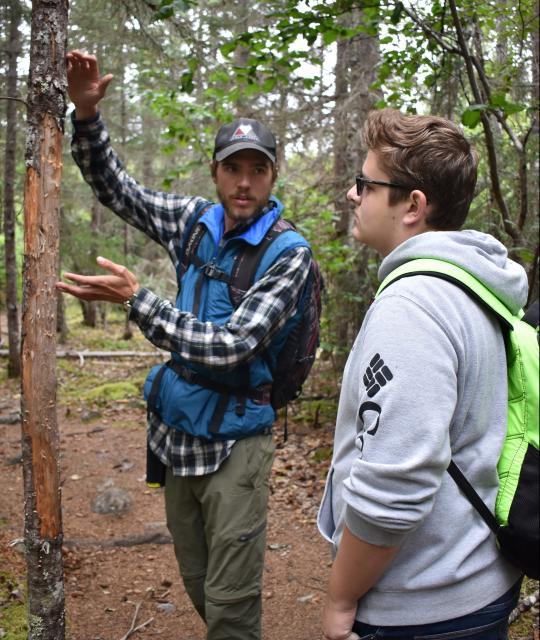 Teens learn about the wilderness on summer adventure travel program in Alaska.