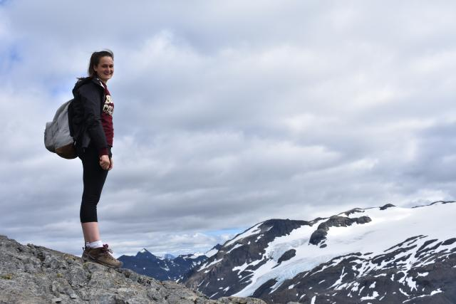 Teen goes hiking in Alaska on summer adventure and service tour.