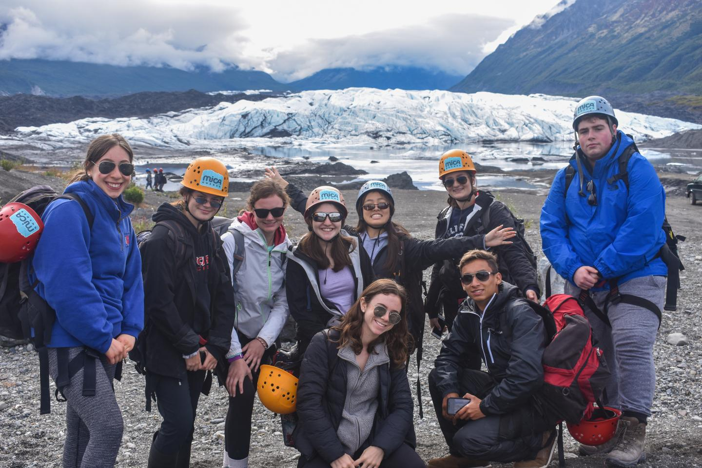 Group of older teens goes ice climbing in Alaska on summer adventure and travel program.