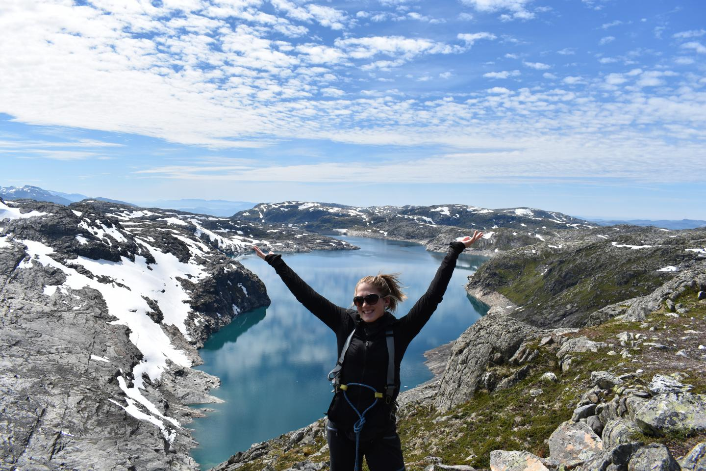 Teenage traveler admires scenic views of Norwegian fjords during summer youth travel program in Scandinavia