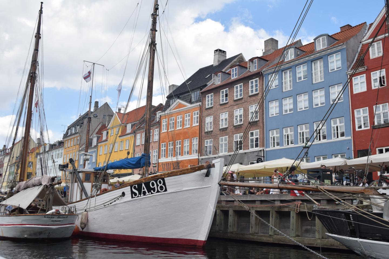 View of Copenhagen Nyhavn harbor seen by teen travelers during summer youth travel program in Scandinavia