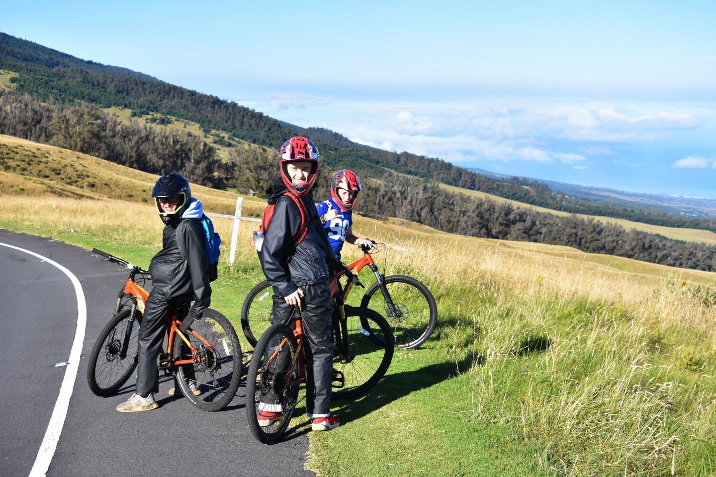 Teens go mountain biking on their summer travel program in Hawaii.
