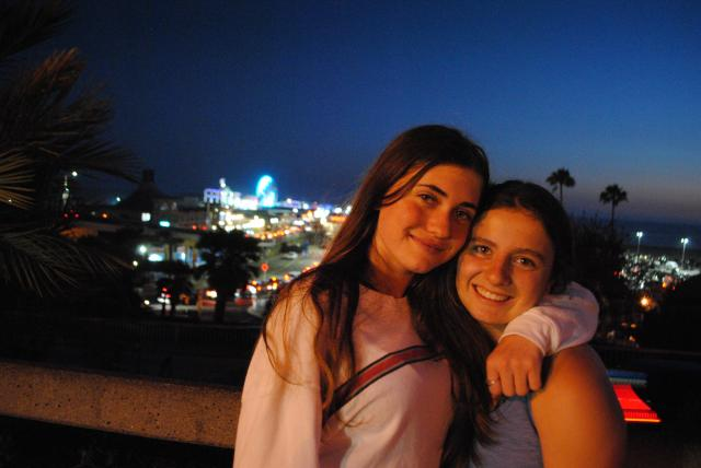 Girls pose for a night photo in California on their summer travel tour for teens.
