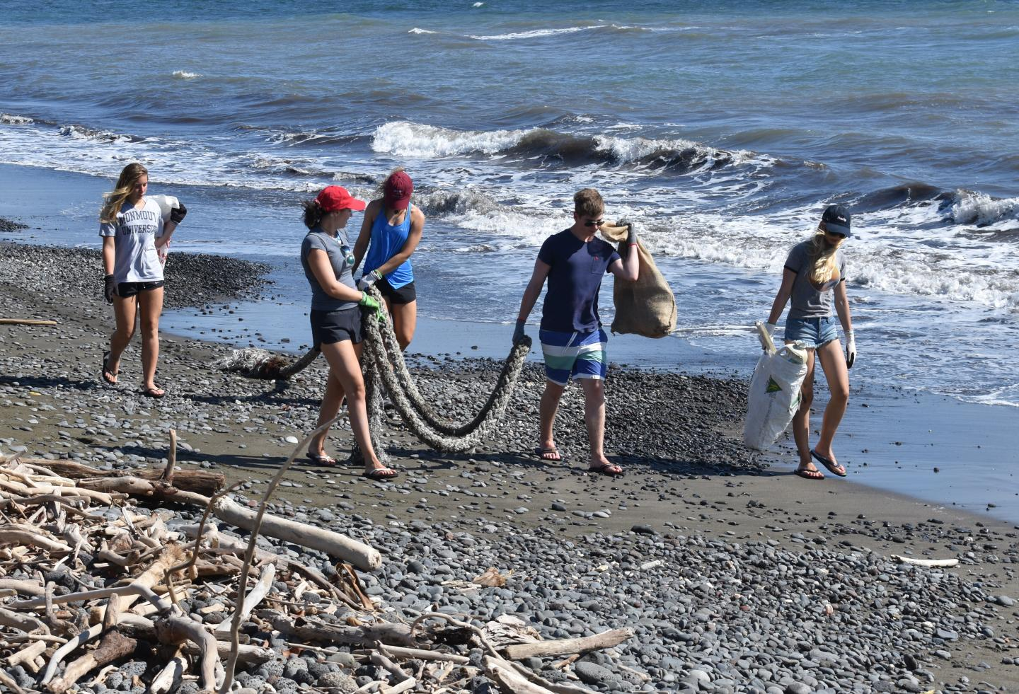 Students do service projects on the beaches of Hawaii and Australia during their teen travel tour.