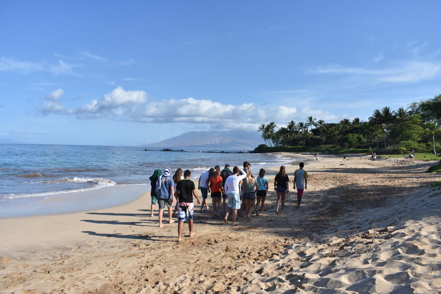 Teens walk along the beach during their travel tour of Hawaii and Australia.