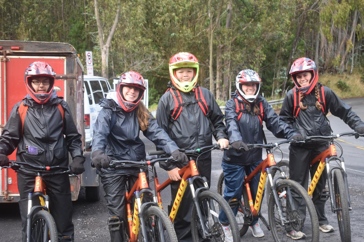 A group of teens goes mountain biking in Hawaii on their summer travel tour.
