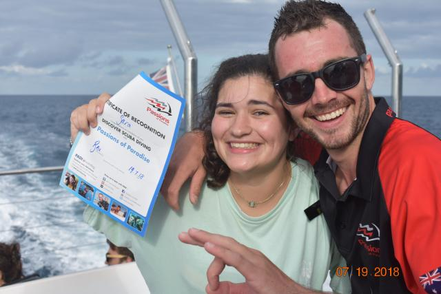 Teen traveler goes scuba diving at the Great Barrier Reef on their high school summer tour to Australia.
