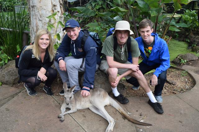 High school travelers hang out with a kangaroo on their summer teen tour to Australia.