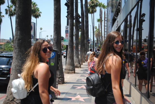 Teens check out the starts in Hollywood on their summer travel tour of California.