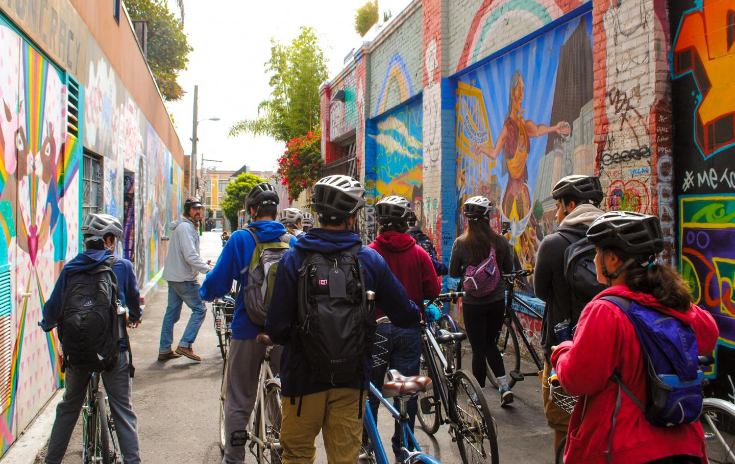 A group of students takes a city bike tour during their summer teen travel program in North America.