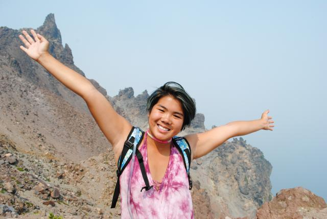 An teen shows their excitement during a summer travel program in North America.
