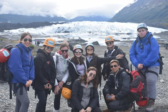 A group of students gets ready to ice climb on their summer travel adventure in Alaska.