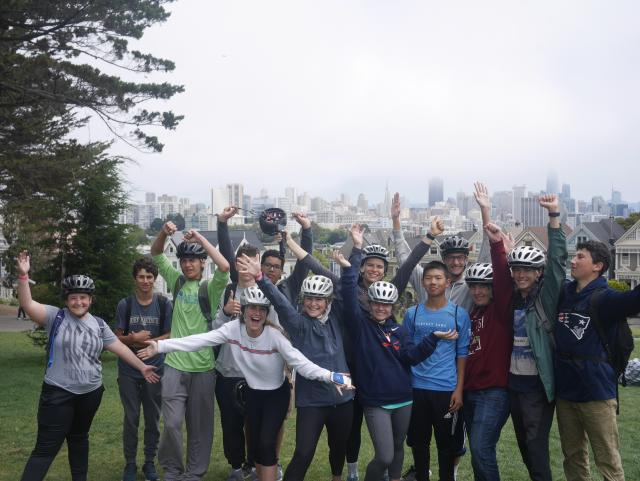 A group of teens takes a city bike tour during their summer adventure tour of North America.