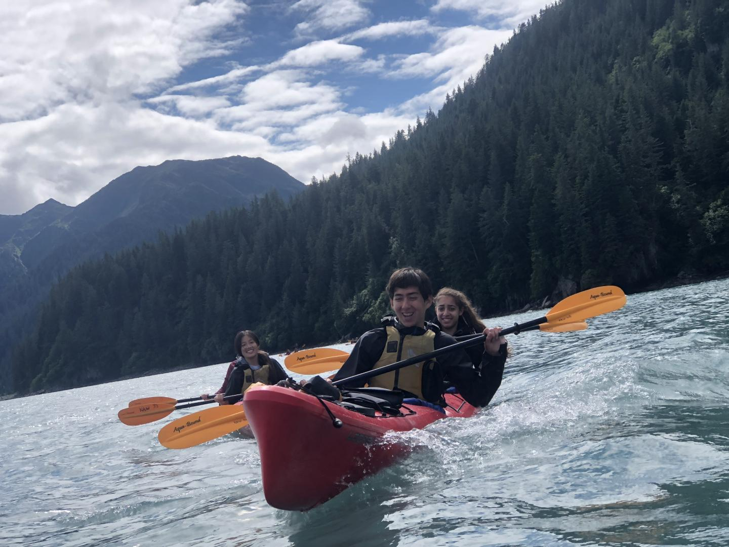 Students go kayaking during their summer teen tour of North America.
