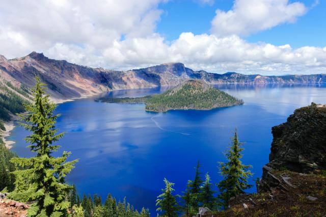 Teens capture a photo of Crater Lake during their summer adventure tour of Oregon.