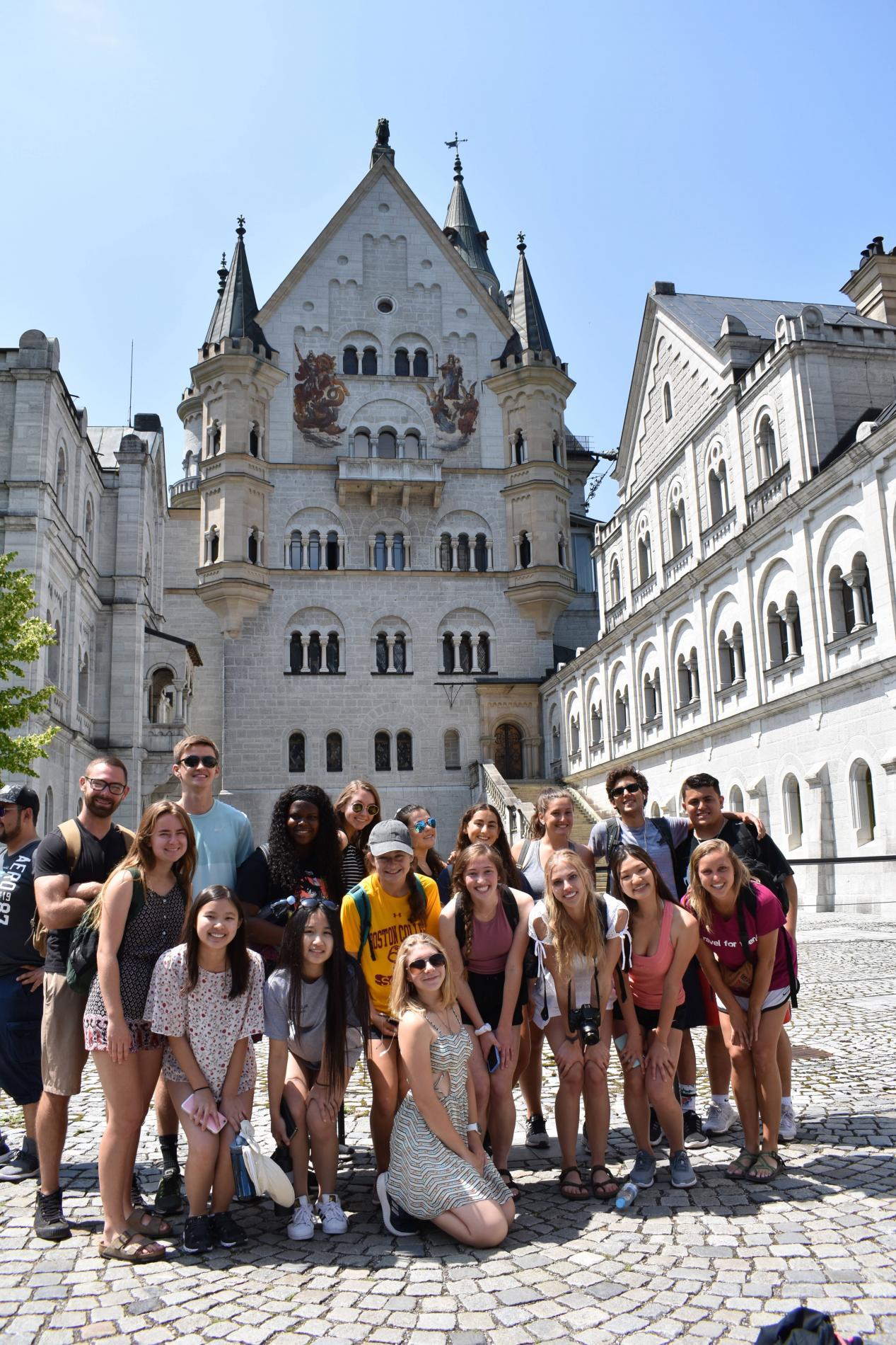 Teen travelers at Neuschwanstein Castle in Bavaria during summer youth travel program