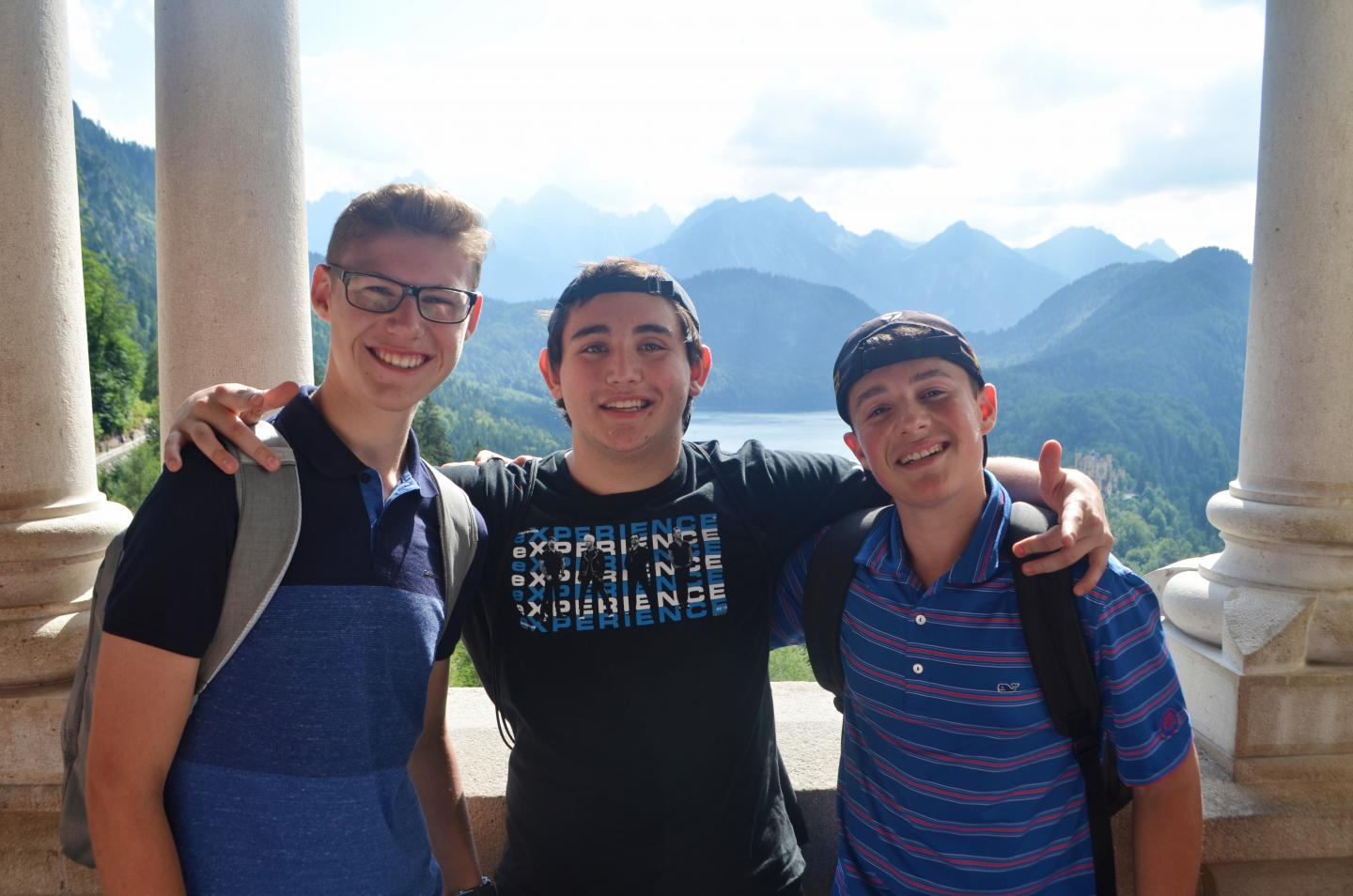 Teen travelers in Swiss Alps during summer youth adventure travel program
