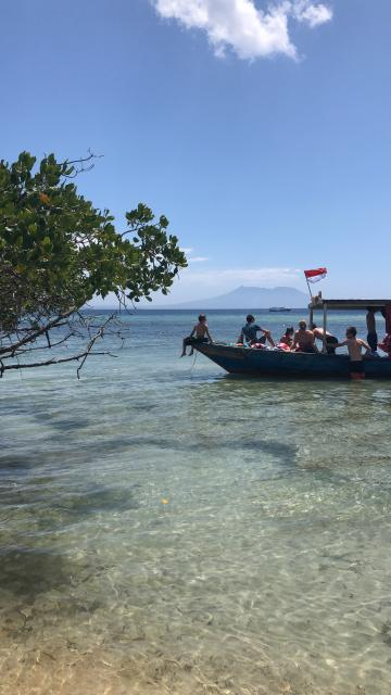 Boat with teens on travel program in Bali, Indonesia