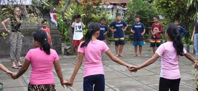 Teens and kids play games in Bali, Indonesia