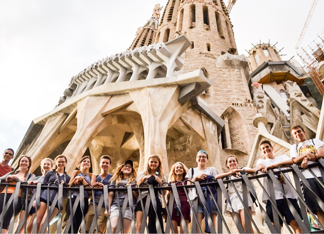Group of teen travelers explores Sagrada Familia in Barcelona on summer travel program