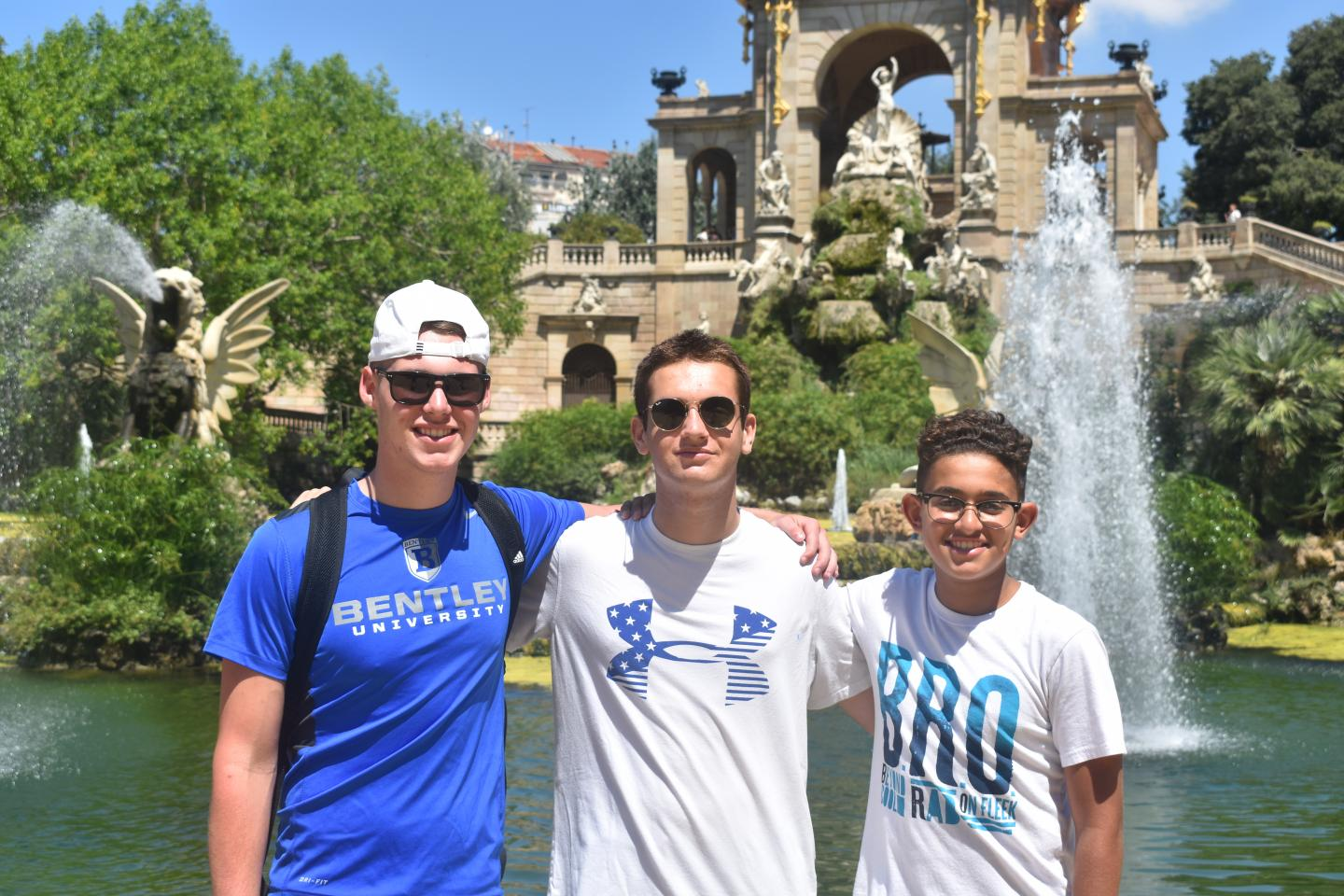 Teenage travelers relax in Barcelona on summer youth travel program