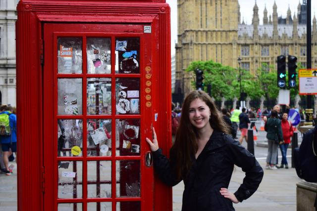 Teen traveler with red phone box and Big Ben on summer youth travel program in England