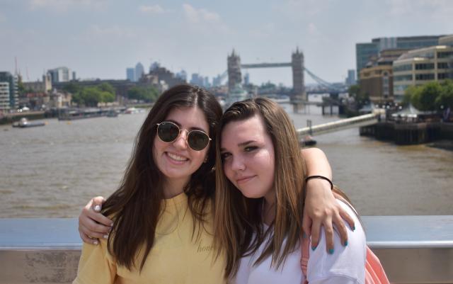 Teenage friends at Tower Bridge London on summer youth travel program