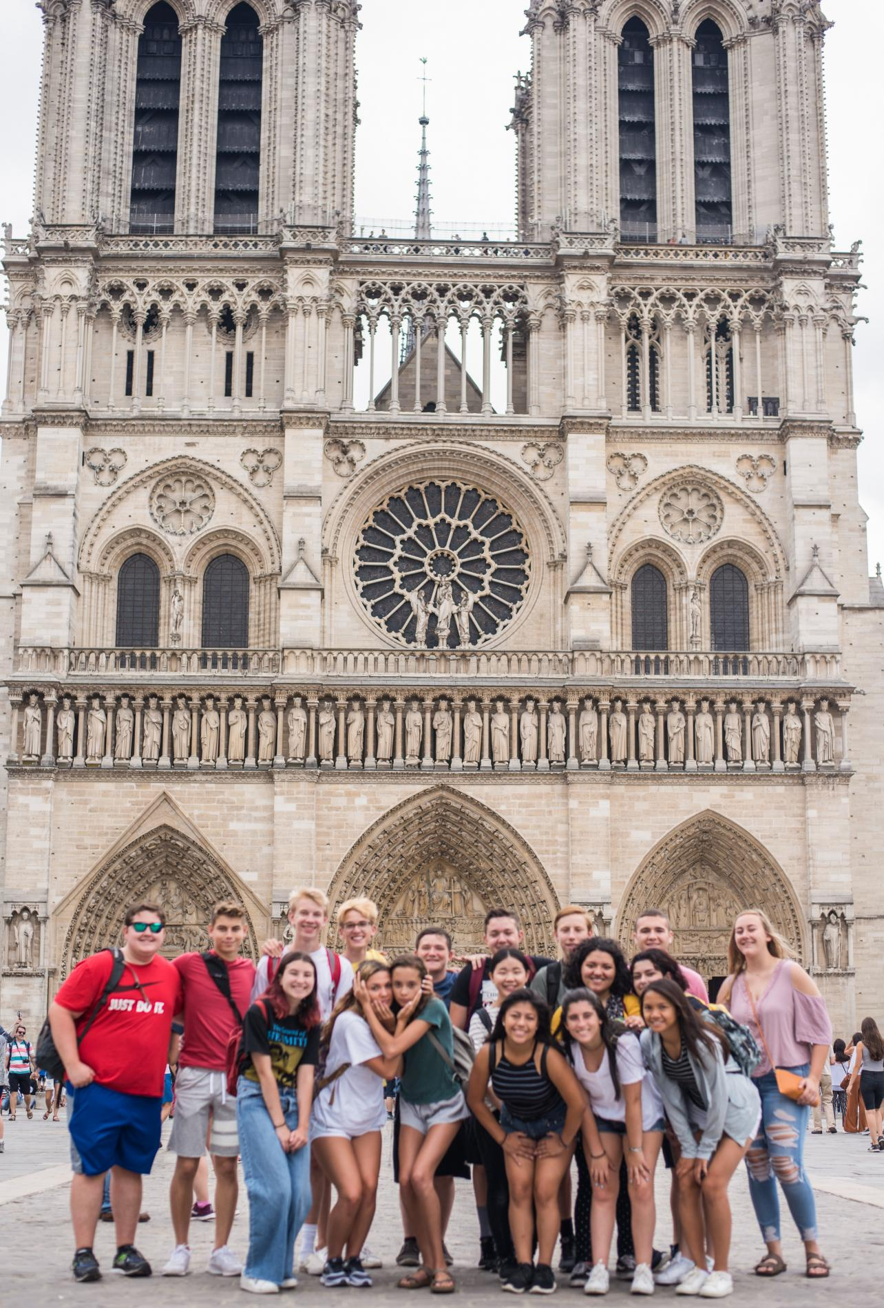 Teen travel group visits Notre Dame on summer youth travel program in Paris