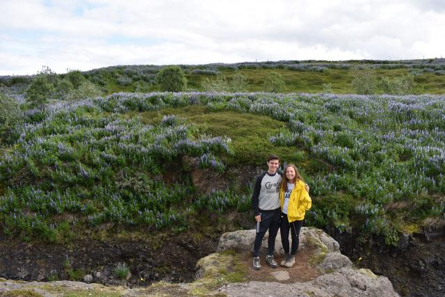 Happy teens with Iceland landscape during summer adventure travel program
