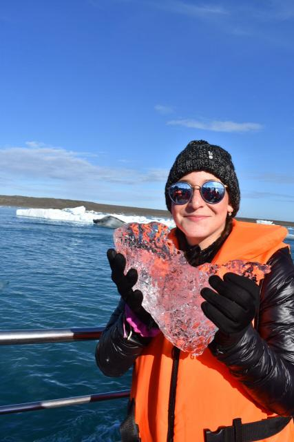 Teen on Iceland boat with ice during summer adventure travel program