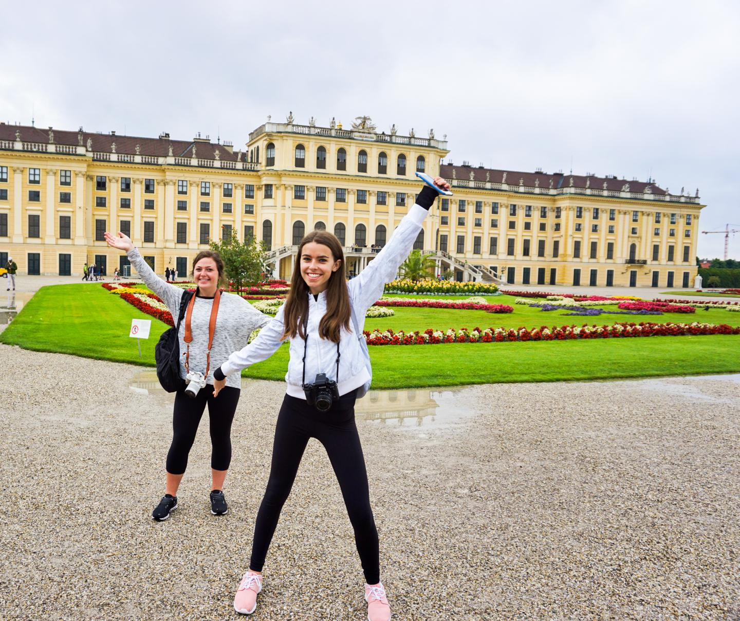 Happy teenage travelers explore Vienna during summer youth travel program