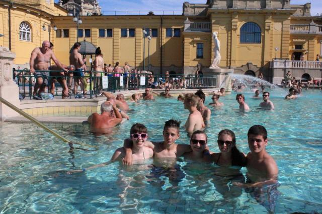 Teenage travelers relaxing in thermal baths in Budapest during summer teen travel program