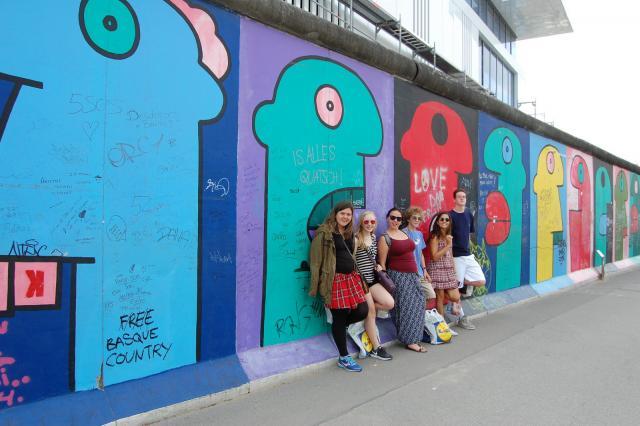 Teen travelers visit Berlin Wall East Side Gallery on summer travel program