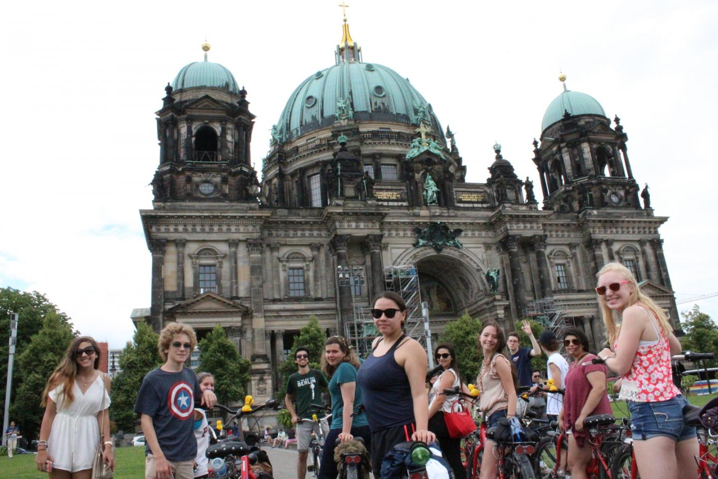 Teenage travelers bike through Berlin during summer youth travel program