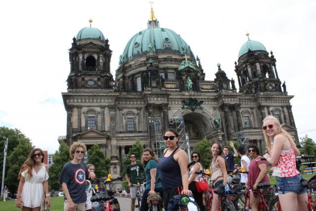 Teenage travelers bike through Berlin during summer youth travel program
