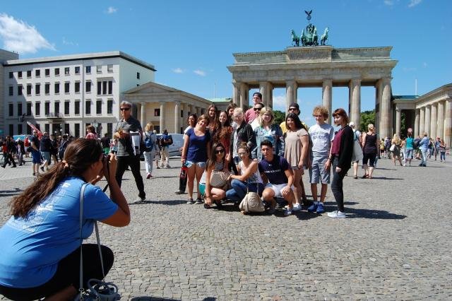 Teen travelers at Brandenburg Gate Berlin during summer youth travel program