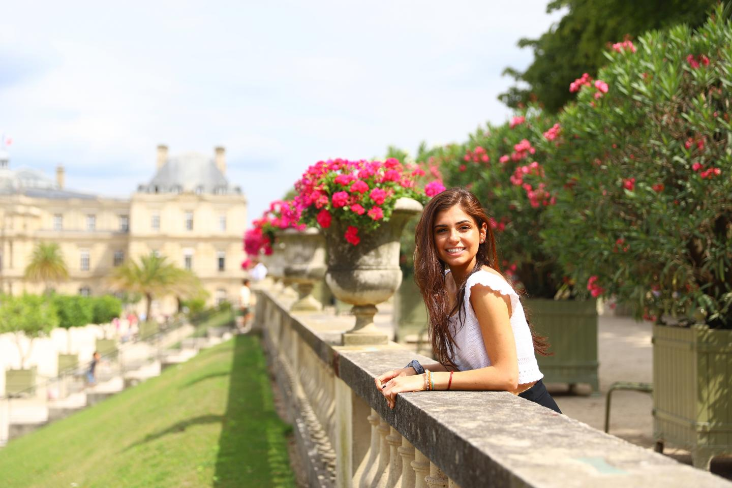 Teenage traveler in Luxembourg Gardens Paris on summer travel photography program