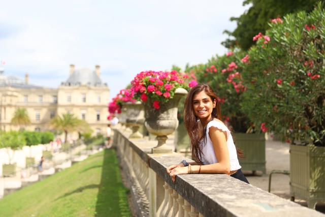 Teenage traveler in Luxembourg Gardens Paris on summer travel photography program