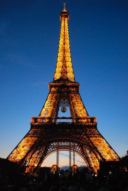 Eiffel Tower lit up at dusk seen on summer teen travel photography program