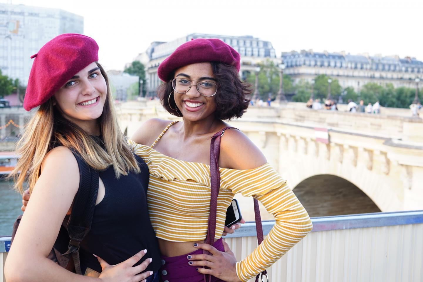 Teenage travelers with berets in Paris during summer travel photography program