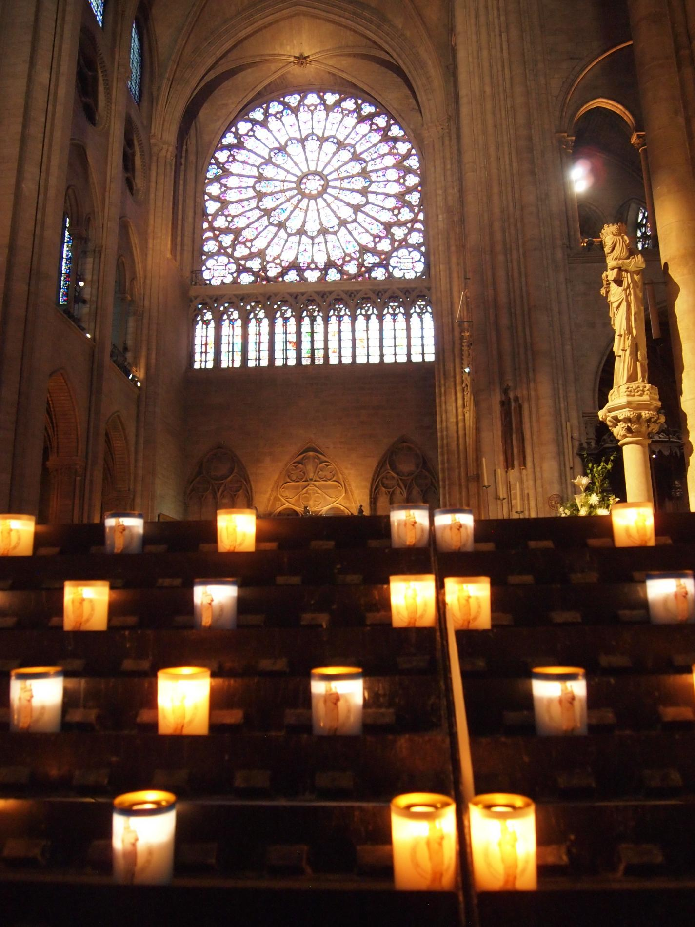 Candles lit in a cathedral