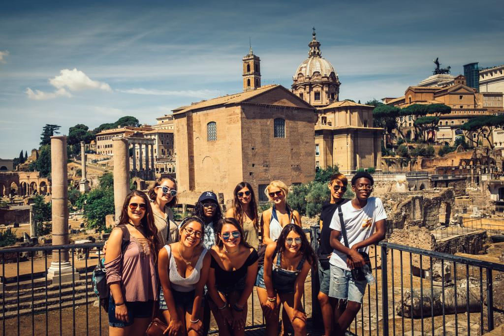High school students smile in Rome during their summer tour of Italy